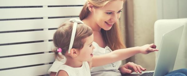 little-girl-and-woman-pointing-at-laptop