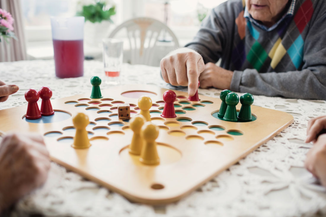 man playing boardgames