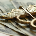 Medical symbol over US dollars